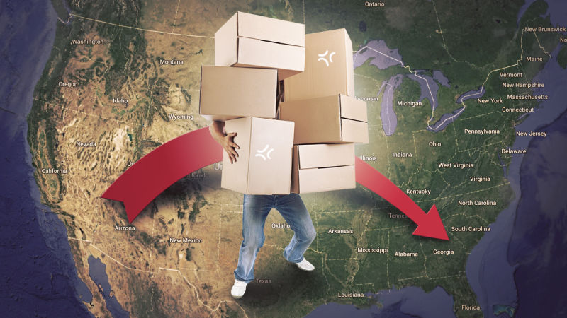 A person with boxes moving from the West Coast