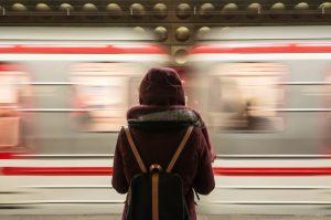 Girl watching passing train