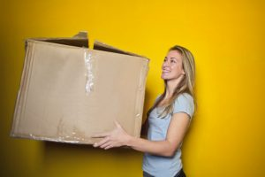 A girl carrying a box