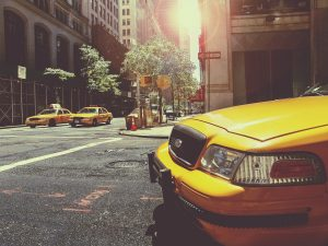 A sunny street in New York. Yellow cab.