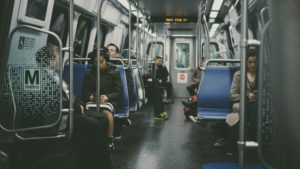 People sitting in a metro.