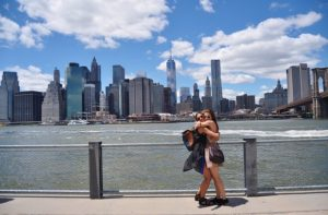 Two girls hugging in Brooklyn