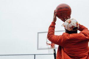 Young man shooting a basketball