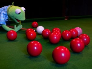 Kermit the frog playing pool