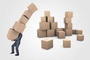 A person that has a lot of moving boxes because they followed our packing guide.
