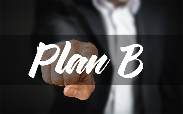 Man pointing at words Plan B