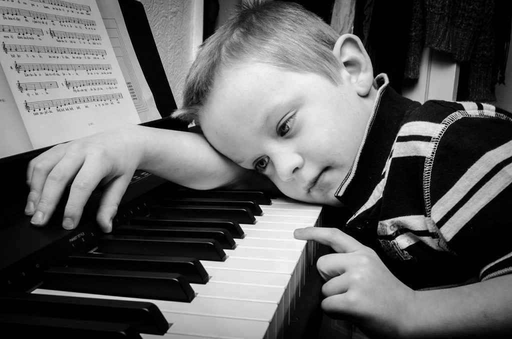 a boy at a piano