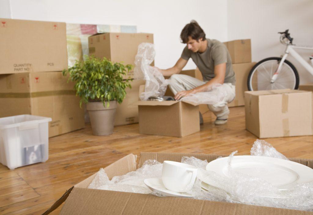man unpacking