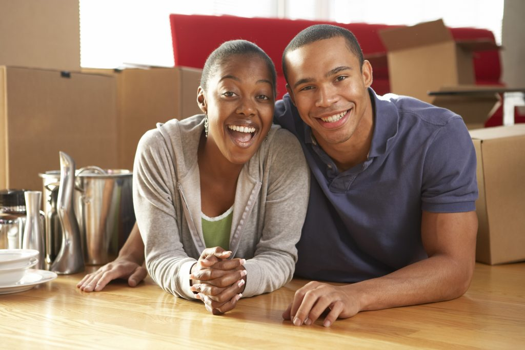 packing services Brooklyn - a happy couple among boxes
