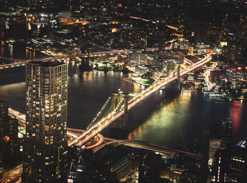 A night-time picture of Brooklyn Bridge and its surroundings