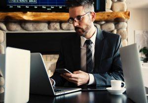 A man looking at his laptop