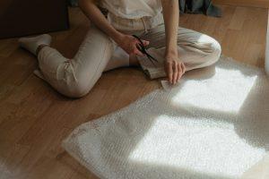 Girl cutting bubble wrap