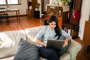 Young woman consider factors that raise moving expenses