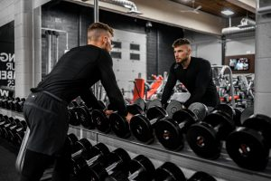 Man in a gym wants to prepare for a day of heavy lifting