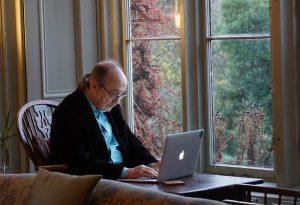 Senior who using a laptop