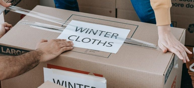 Close up picture of the box with label winter cloths on it