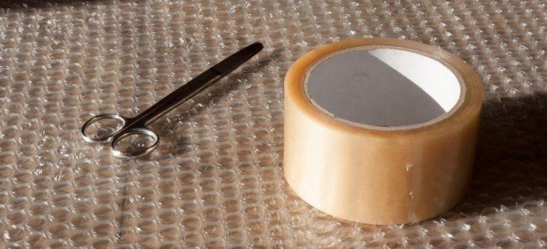 bubble wrap, scissors and tape