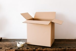 A box and tape you'll need for moving your liquor cabinet