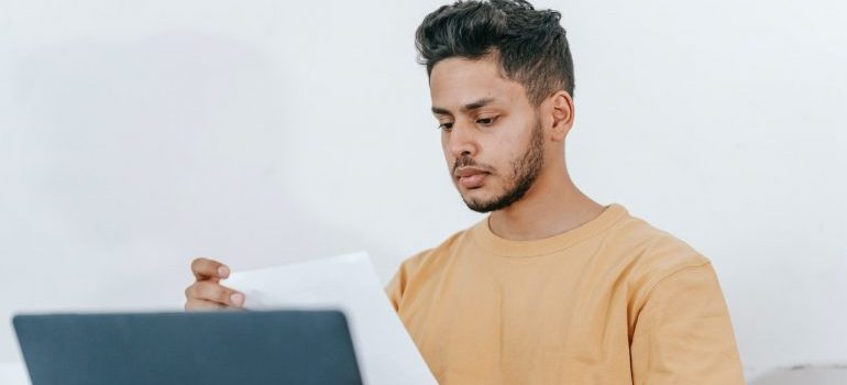 Man reading reviews on the internet