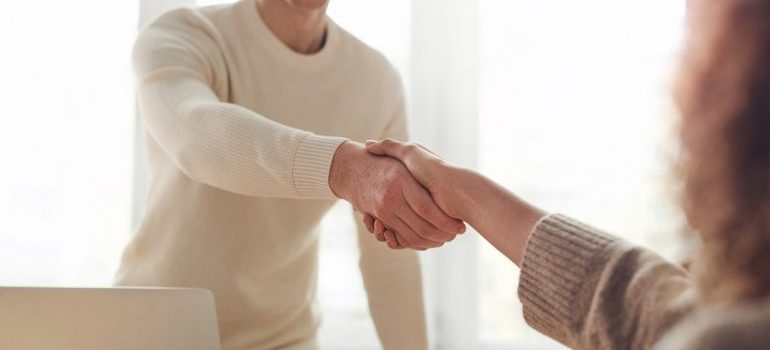 People shaking hands after making a deal